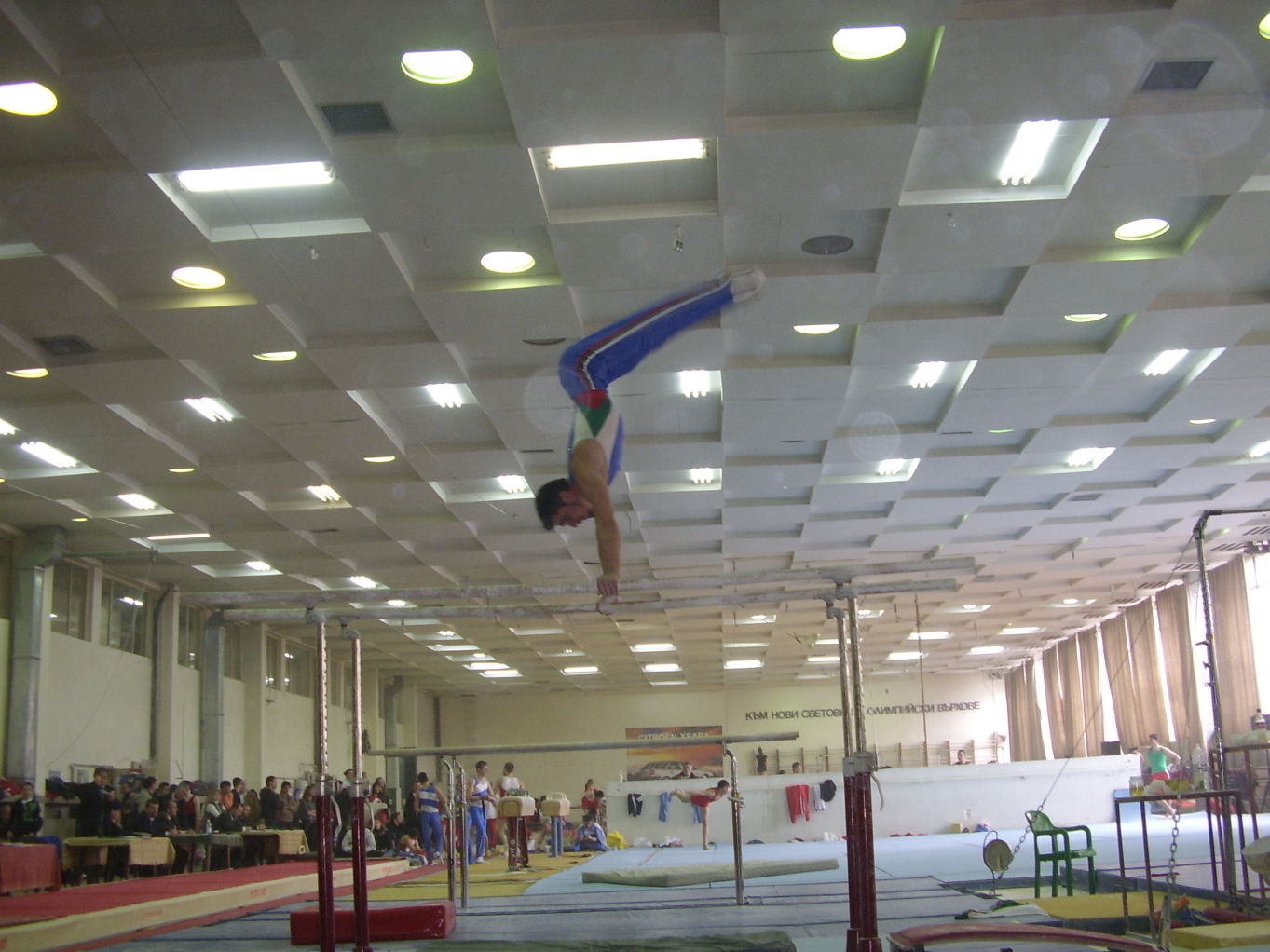 Press to handstand on Parallel Bars