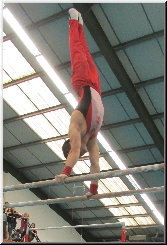 Stefan Kolimechkov on Parallel Bars at Sutton Gymnastics Academy in London