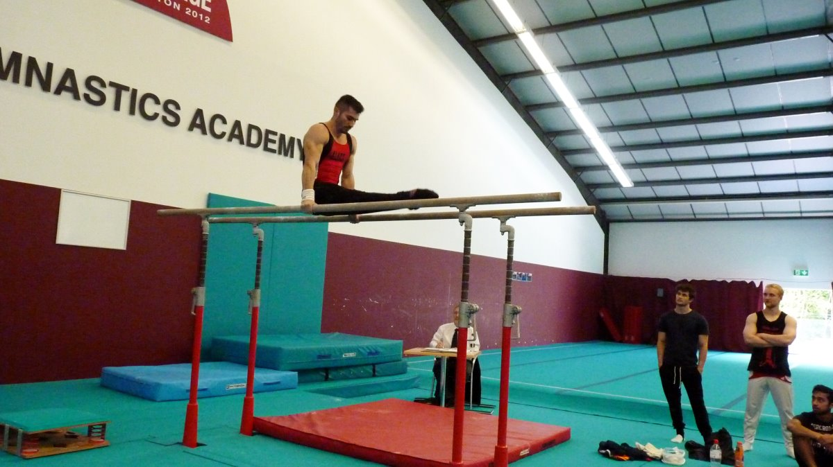 Stefan on Parallel Bars at Sutton Gymnastics Academy