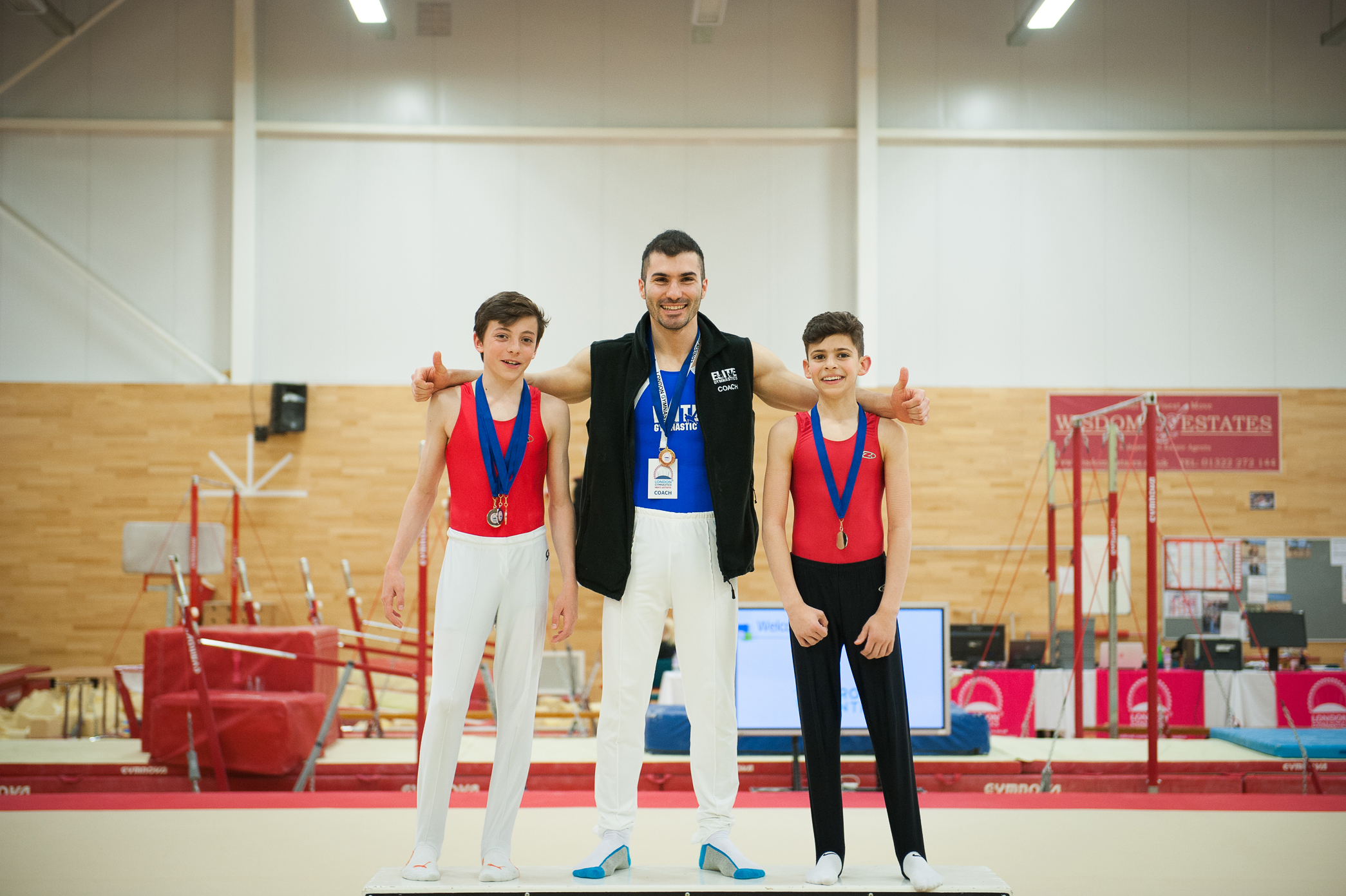 coach Stef and his gymnasts from the Elite G.A. after the event