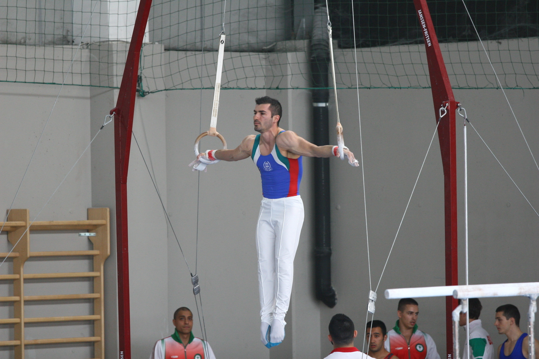 Stefan Kolimechkov Performing the Iron Cross on Rings