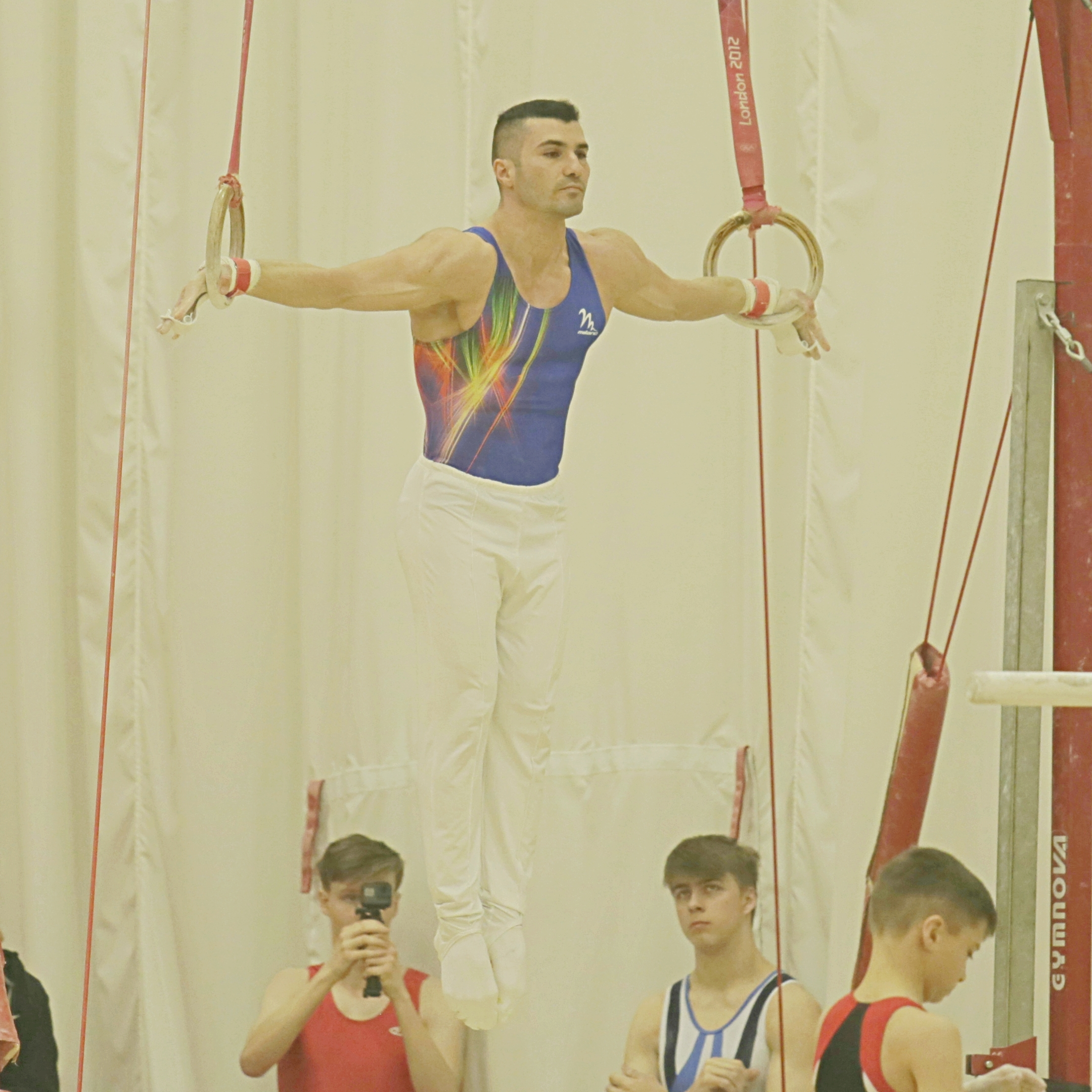 Dr Stefan Kolimechkov competing on Rings in London
